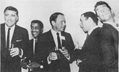 Folk music fans do not appreciate the boozy badinage of Messrs. Sinatra, Lawford, Martin, Bishop, and Davis, Jr.